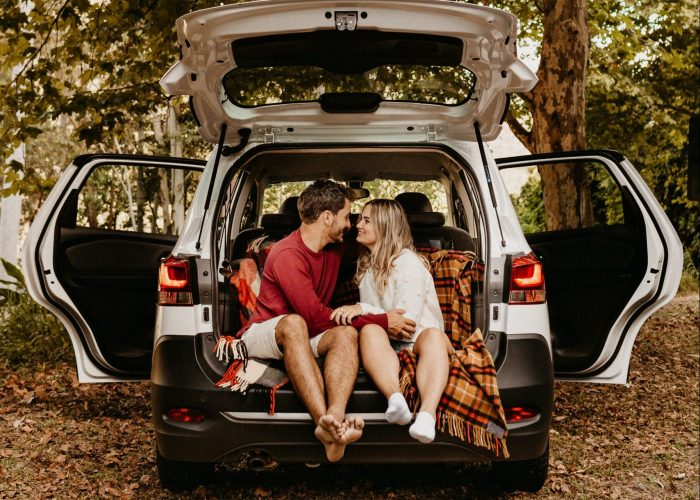 photo-of-couple-sitting-in-the-back-of-car-3021263